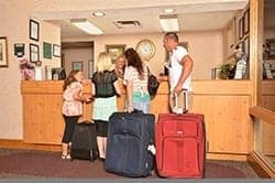 Family checking in to All Season Suites hotel in Pigeon Forge