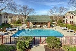 View of the outdoor swimming pool at All Seasons Suites