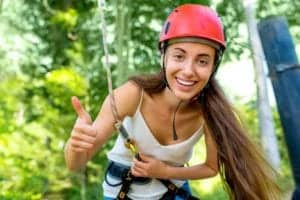 Teenage girl preparing to go ziplining.
