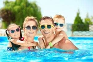 A family having fun at a swimming pool.
